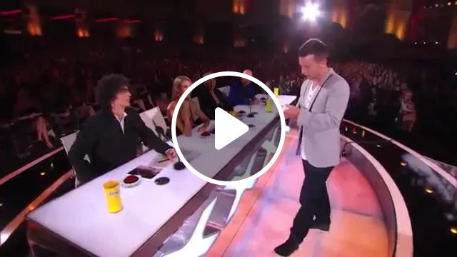 Smart man performing magic with a smartphone