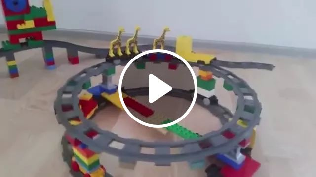 Electric Toy Plastic Train Is Assembled With A Very Nice Lego - Video & GIFs | train, plastic toy, electric, assembled, lego, very beautiful