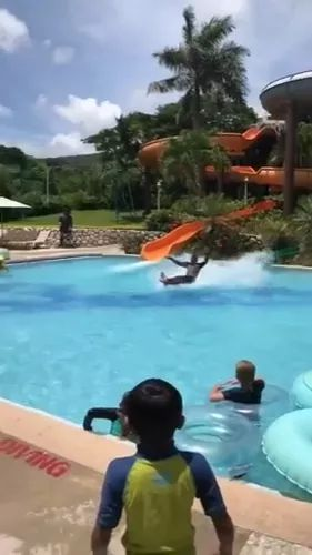 talented man performs a slide in pool
