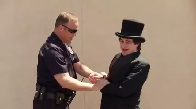 on the street, Man in a vest, performing magic in front of police