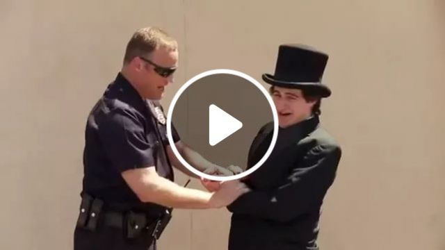 on the street, Man in a vest, performing magic in front of police, street, vest, performing, magic, police, sunglasses, luxury vehicle