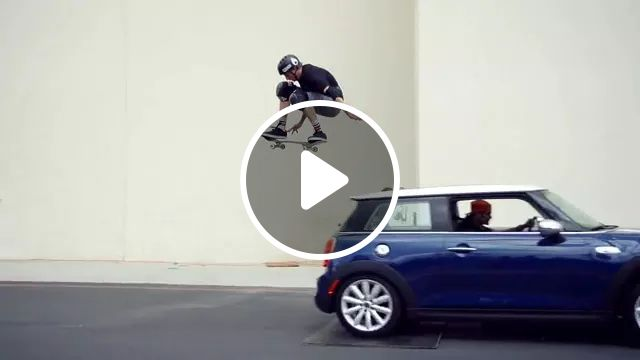 Man jumps a moving luxury car on his skateboard