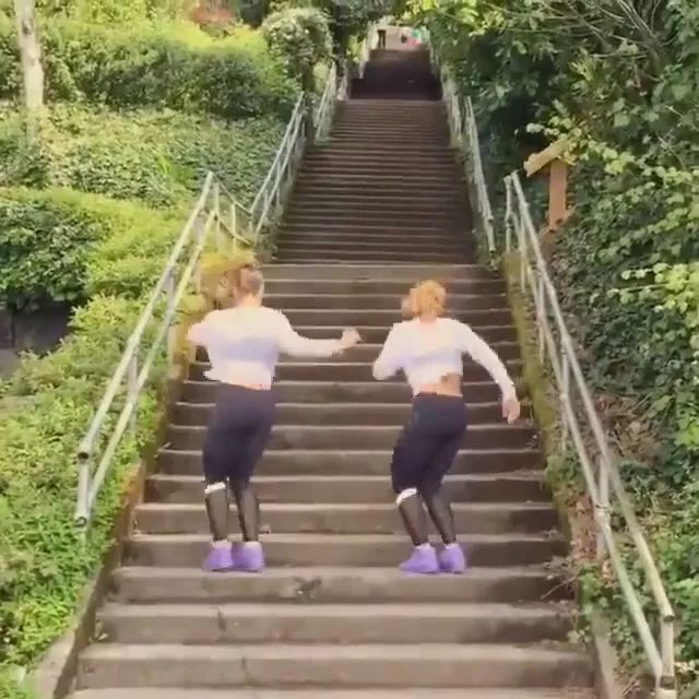 Two girls exercise by going upstairs, very good for health