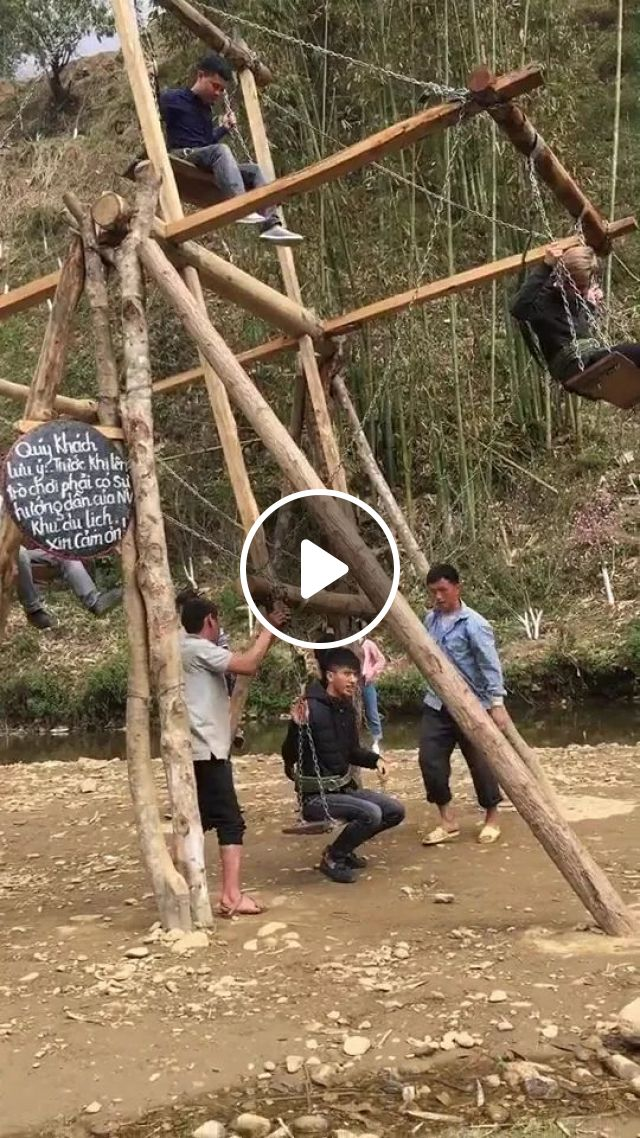 Men Are Playing On The Wooden Ferris Wheel - Video & GIFs   men, fashionable clothes, fashionable shoes, playing, on wooden ferris wheel