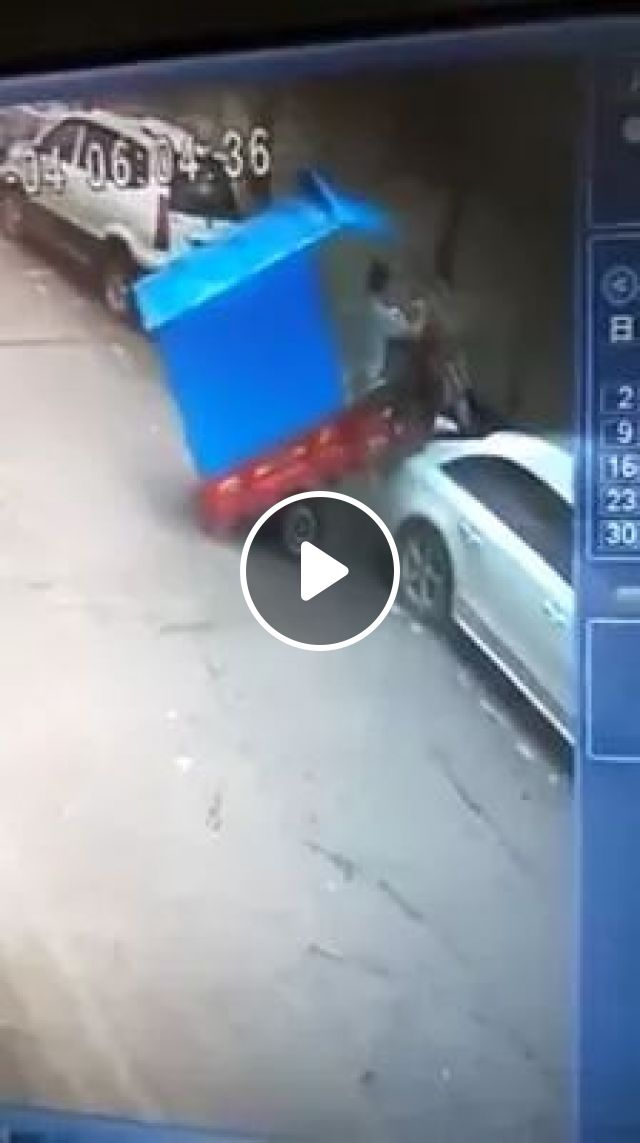 a man drove a tricycle and stopped on a luxury car roof
