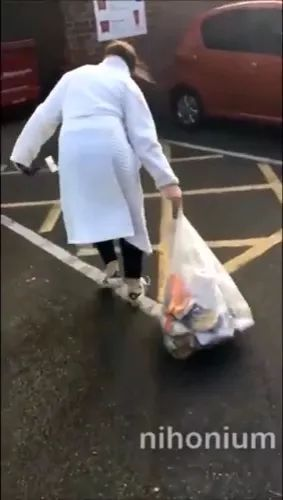 on the street, woman dumped garbage in trash