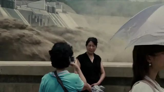 Tourists photographed next to hydroelectric dam