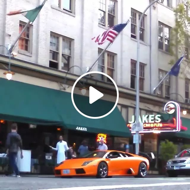 In Front Of Restaurant, A Man Rides A Bicycle Through Luxury Car Roof. - Video & GIFs | restaurant, waiter, man, walk, bike, roof, luxury car