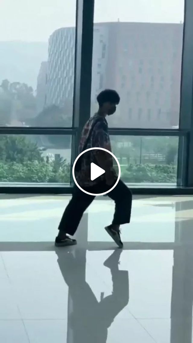 A Man Performs Dance On The Smooth Background Of Building - Video & GIFs | men, men's fashion, performances, dance, smooth background, buildings, high-class buildings