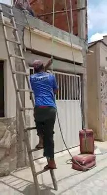 Man lifted cement bag, but broken cement was spilled - Video & GIFs | man, workers, lifting, cement bags, torn bags, pouring out, building houses and works
