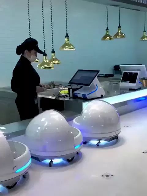 This restaurant has little robots that deliver your food