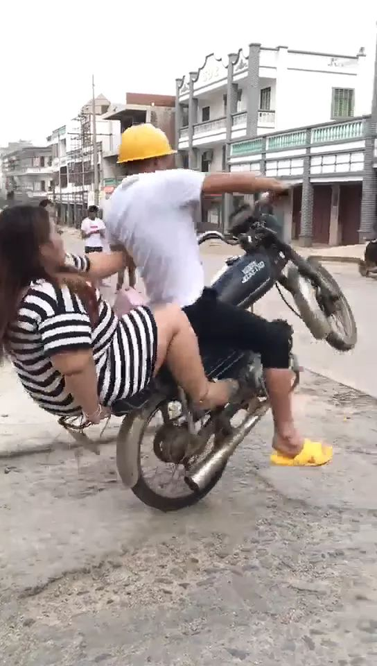 Girl need to lose weight to be able to sit safely in a motorbike