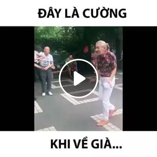 elderly fashionable clothes dancing in park to reduce stress