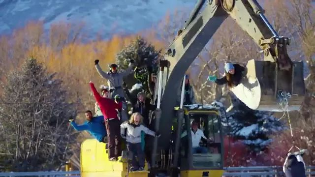 In winter, people have fun with excavator