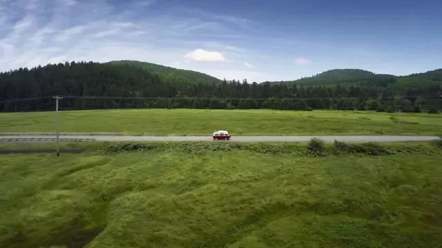 Journey of luxury car through coast and hills