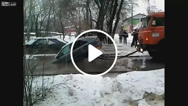 truck pulled luxury car stuck in water hole, Rescue, automobile, accident, luxury vehicles, street, car insurance