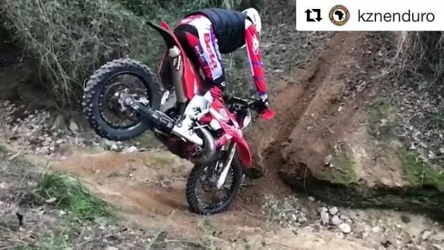 Man driving sports motorcycle through obstacles