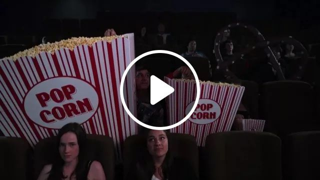 In cinema, family is watching movies with giant popcorn bags, movie theater, family, family fashion, watching movies, popcorn bags