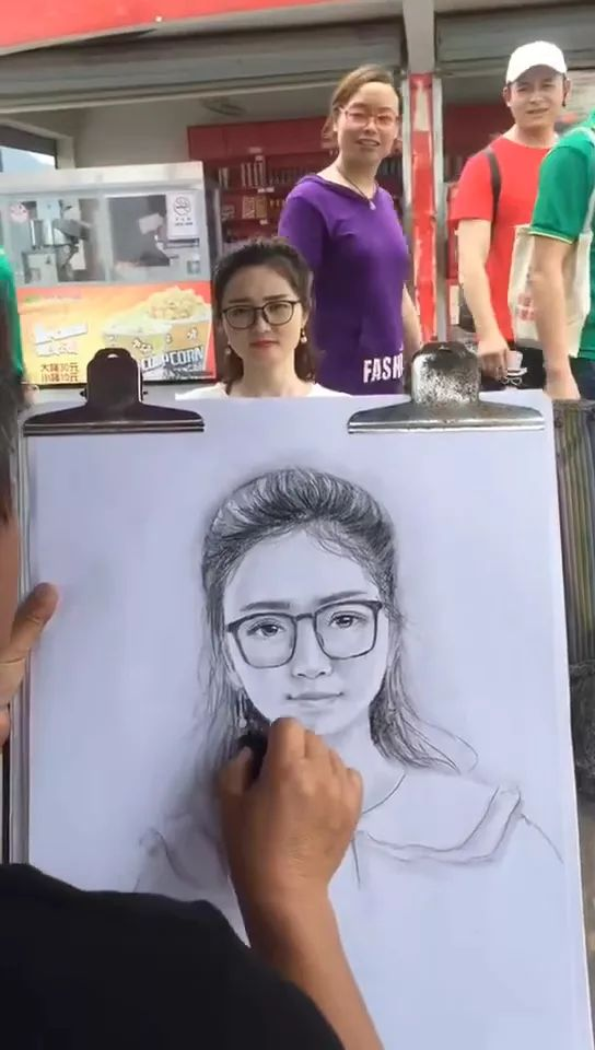 Street artist painting in China