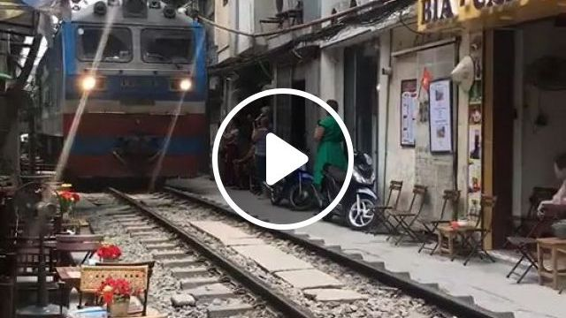 Traveling To Vietnam To Drink Coffee And Watch Trains - Video & GIFs | vietnam travel, drink coffee, watch trains, coffee shop