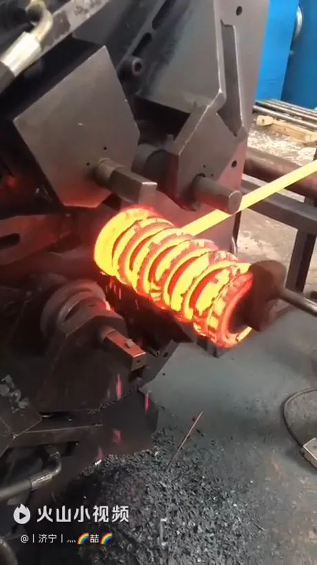 This spring is coiled with mechanical machine - Video & GIFs | steel technology,mechanical machines,automatic systems