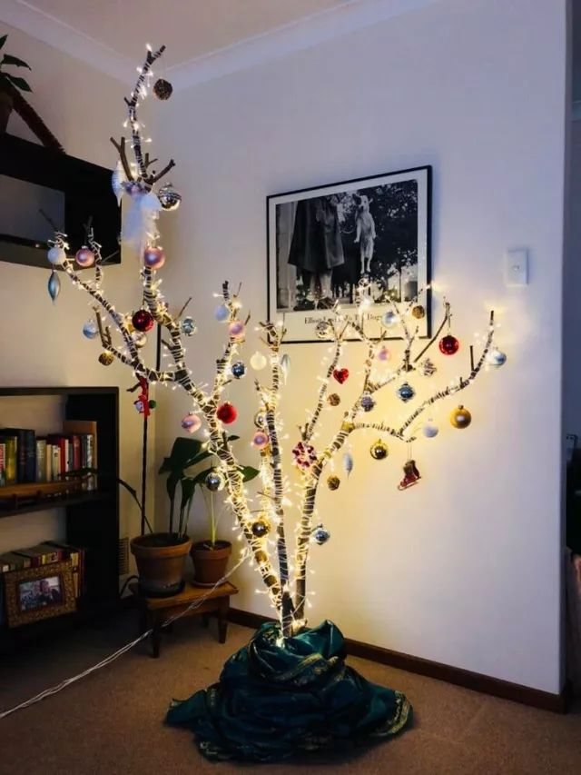 This year I decided to not buy an $80 Christmas tree but instead made my own from branches from my backyard. I miss the smell of a real tree but they only last for 2 weeks in a Perth summer anyway.