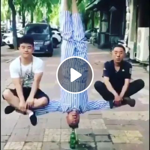Man Performing With A Bottle On The Street - Video & GIFs   man, male fashion, performance, bottle, street
