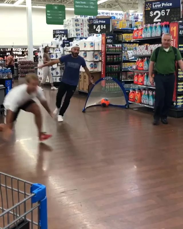 men play football in supermarket - Video & GIFs | men, men's fashion, sports shoes, playing football, supermarkets, consumer goods, household appliances