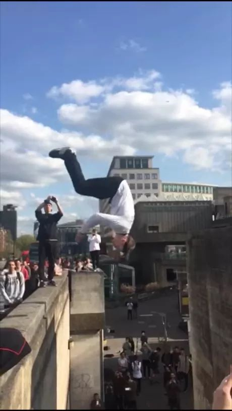 Smartphone records scene of a man jumping over two buildings