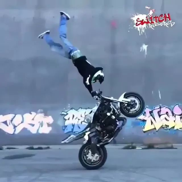Man performing motorbike driving with rear wheels