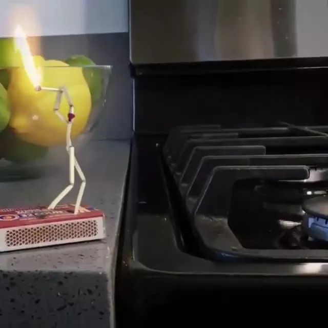 In kitchen, fire from gas stove is turned on by a matchstick