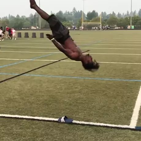 Acrobatic man performing on the stadium