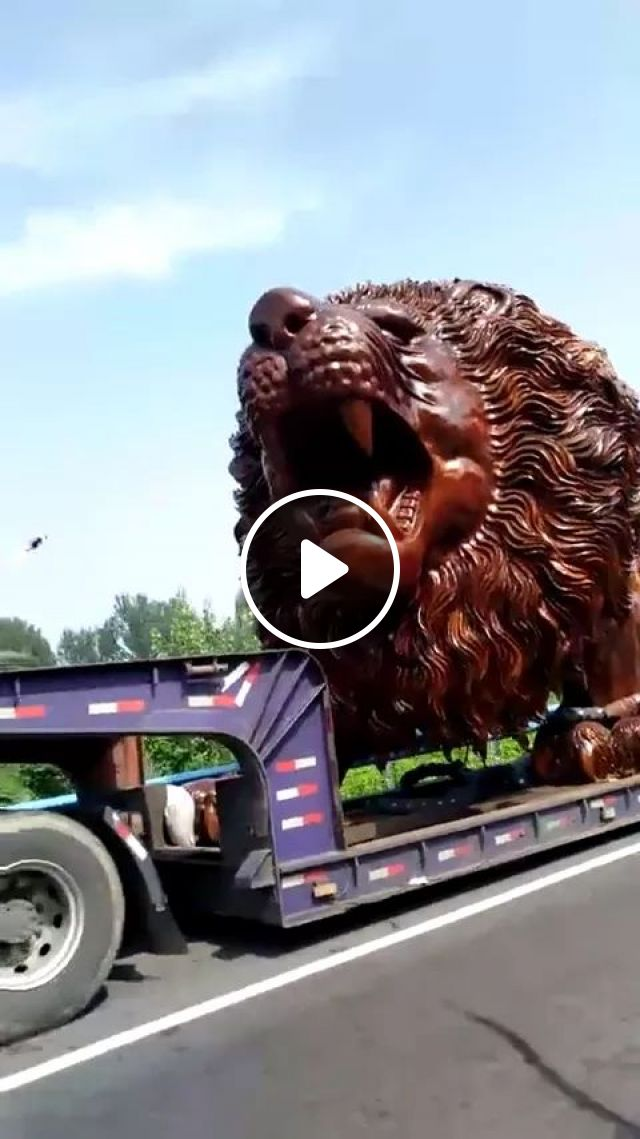 on the street, tractor truck is transporting huge wooden lion, street, tractor truck, transport, giant wooden lion, product