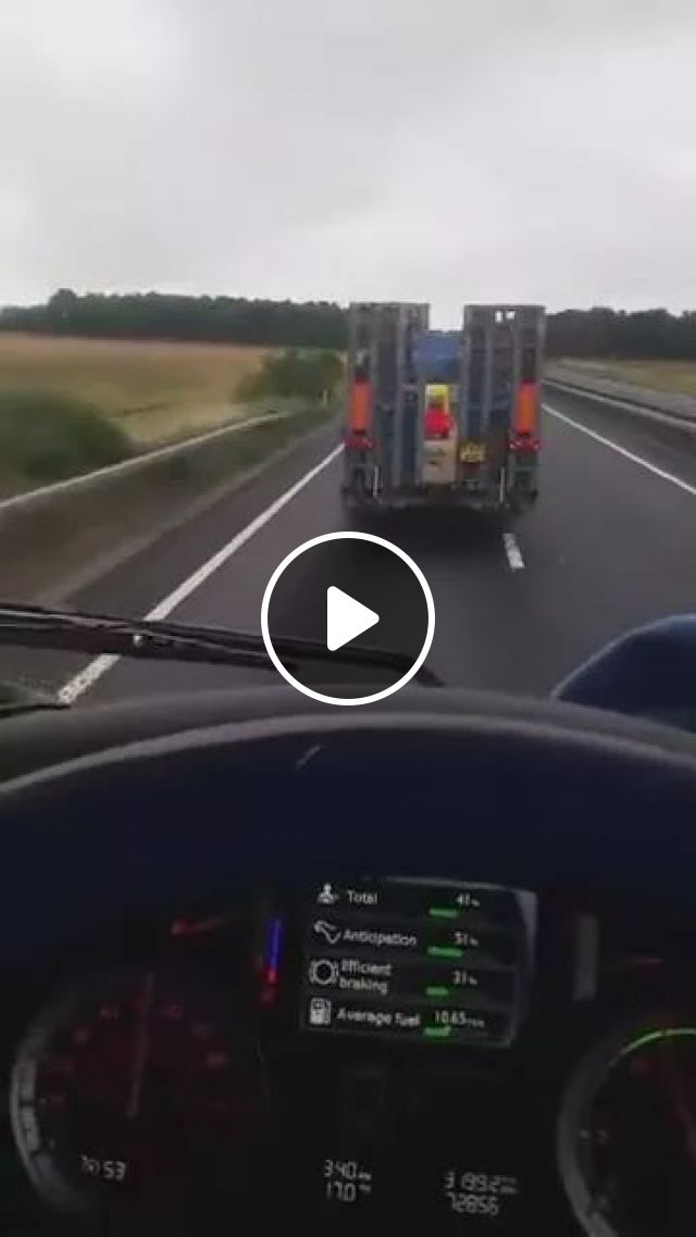 Tractor truck carrying a toy car on American streets
