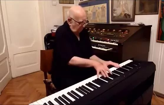 Granddad plays piano, melody sounds great