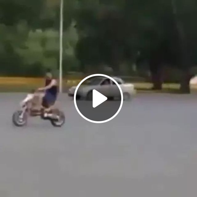 poor man driving a motorbike on the road dropped front wheel