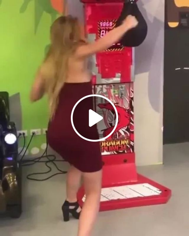Girl practicing punching with machine, Girls, women's fashion, practice, punches, fitness machines, sports equipment