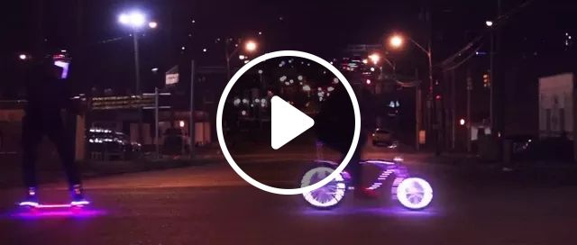 on the street, bike and skateboarding with colorful lights