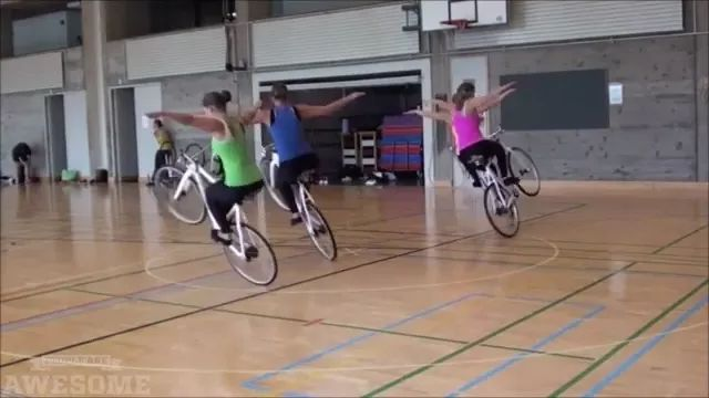 Women perform cycling with a wheel
