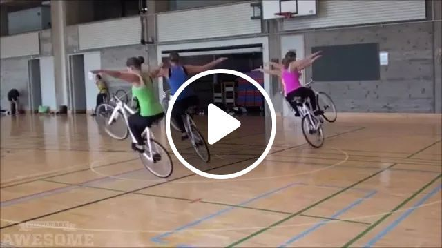 Women Perform Cycling With A Wheel - Video & GIFs | women, women's fashion clothes, performances, cycling with a wheel