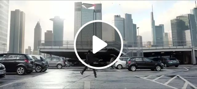 Dancing man in modern city with luxury buildings and vehicles on the street