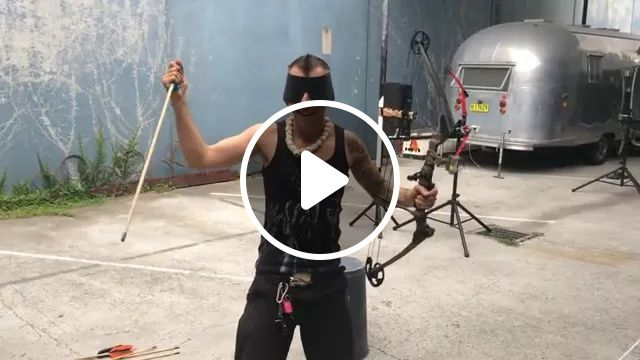 a man caught arrow at a very high speed, Man, male fashion, bows, arrows, high speed