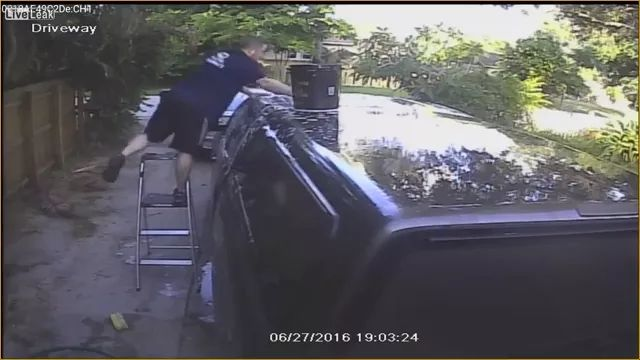 Camera recording a man cleaning luxury car