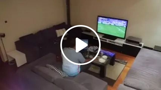 Husband watching football on television