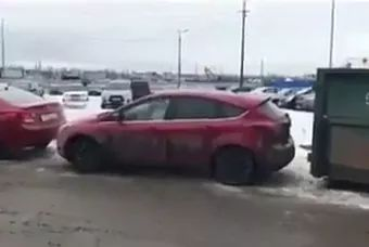 girl tried to move car in parking lot.