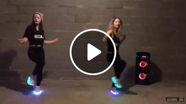 Two girls dance on glowing shoes