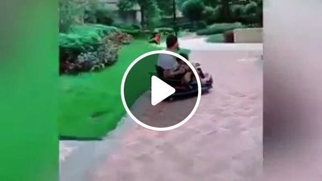 Dad And Son On Electric Car Toy In Yard. - Video & GIFs | Dad, son, children's fashion, toy electric car, yard.