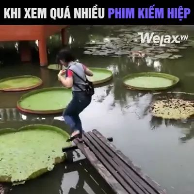 During tour, girl steps onto leaf on the pond - Video & GIFs | travel trip, girl, fashionable clothes, fashion bag, step on the leaf, on the pond