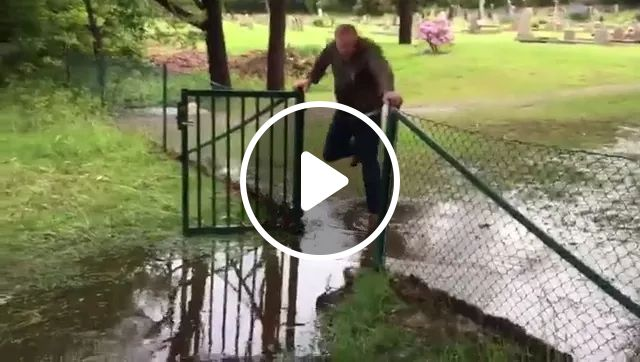 A Man Walked Through Gate And Did Not Want To Wet Luxury Shoe - Video & GIFs | man, going through, gate, luxurious clothes, wet, luxury shoes