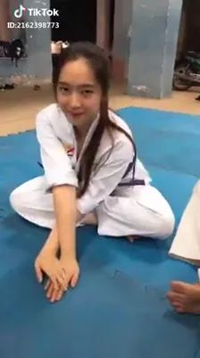 Girl practicing karate, beautiful girl, sports clothes, karate training